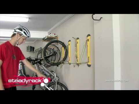 ▶ User instruction for the Steady Rack, the smart way to store your bike! Fietsophangsysteem! - YouTube