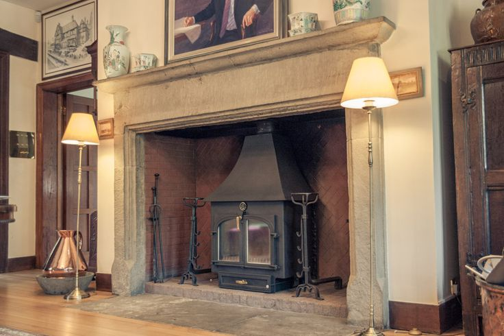 The Clearview 750 High Canopy 14kW stove in a listed manor house in Buckinghamshire.