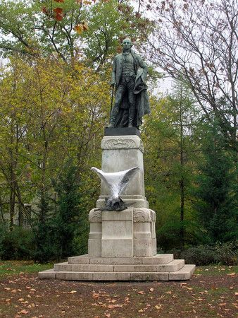 A statue pays tribute to American president George Washington in City Park in Budapest, Hungary. A statue of an eagle is wrapped in plastic to protect it from damage.
