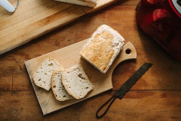 Gluten free, vegan Bread SRLSY Classic Sourdough Loaf on a cutting board