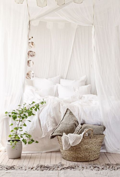 Light airy looking all white canopy bed
