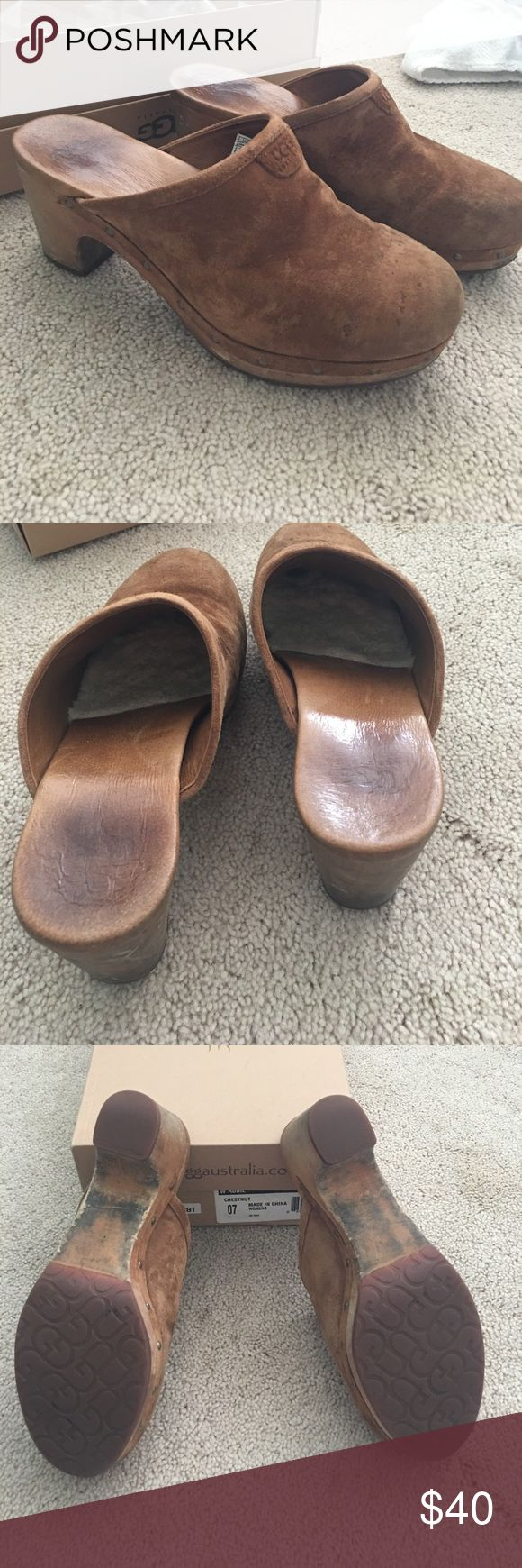 Ugg size 7 suede mule clogs with wooden heal These are awesoem and timeless.  The clogs are the perfect height for a little lift. They are lined on the inside loft extra warm. A beautiful chestnut suede. Included the original box- minimal wear UGG Shoes Mules & Clogs