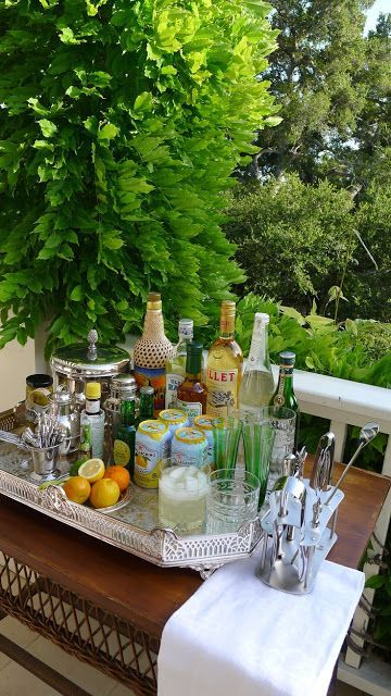 Pretty self service bar so guests can refresh or make their own drinks. Lovely vintage silver tray with a linen towel are elegant against the greenery of the garden.