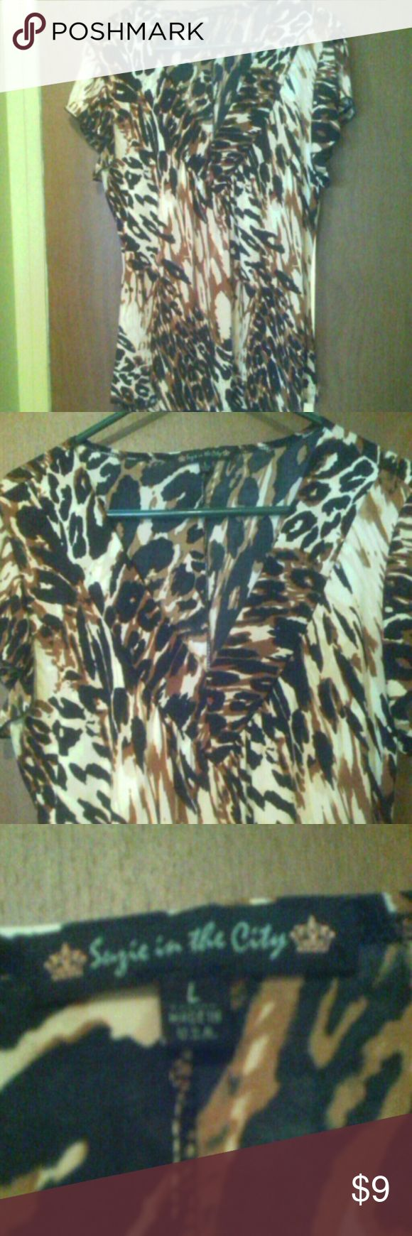 Black,Brown, and Cream Cap Sleeve Blouse Animal Print Black,Brown,and Cream Blouse. With capped sleeve Tops Blouses