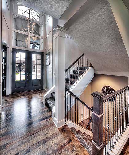 Open 2 Story Entryway, Glass Double Doors, White Wainscoting, Mirrored Entryway