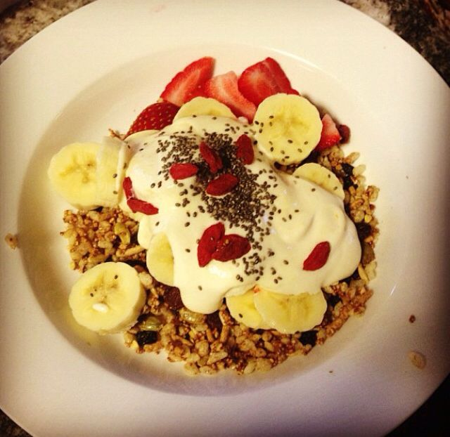 Homemade toasted granola partnered with sliced banana strawberries and Greek yoghurt
