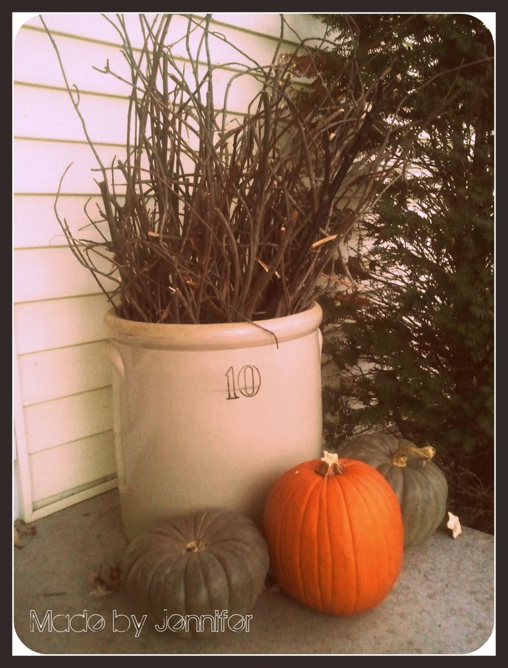 What started as a dreaded chore turned into cute decor for my porch.  I was picking up the broken tree branches in my yard after a windy night and realized they would look great in my empty crock on my porch.  I love rustic fall decor, and the best part, FREE!