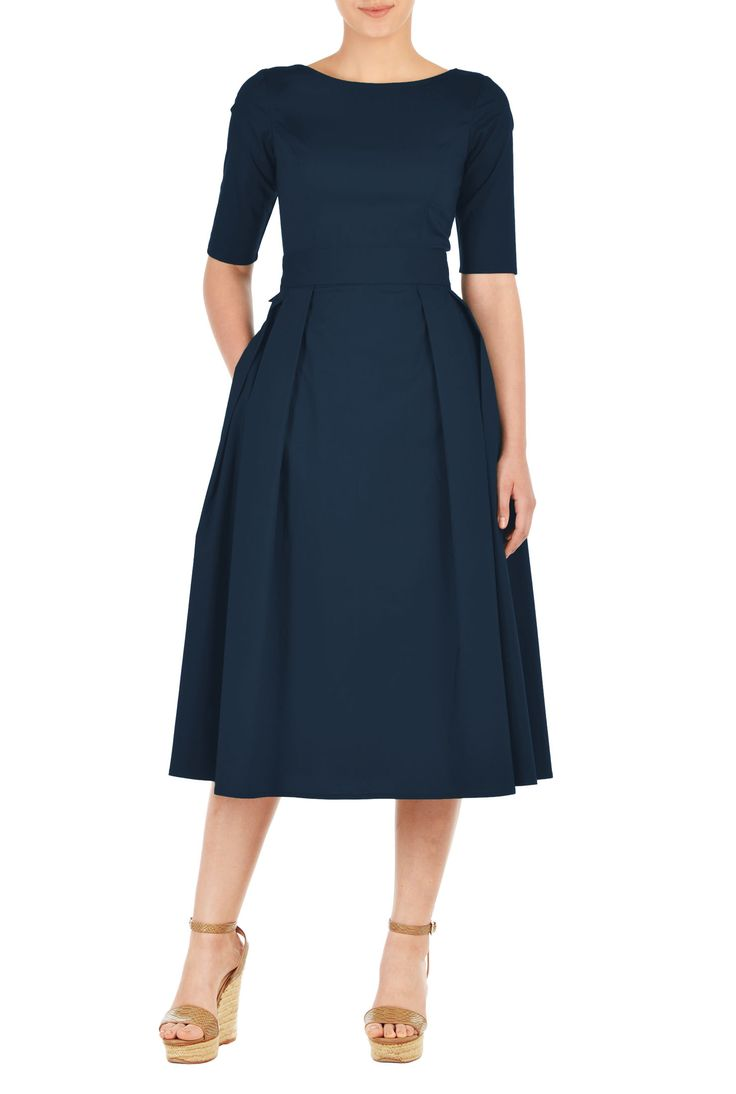 Our cotton poplin dress is cinched in with an elasticated self-belt and a wide bow at the back. The princess-seamed bodice and pleated skirt are classically flattering, while pockets and a midi-length hemline offer modern elements.