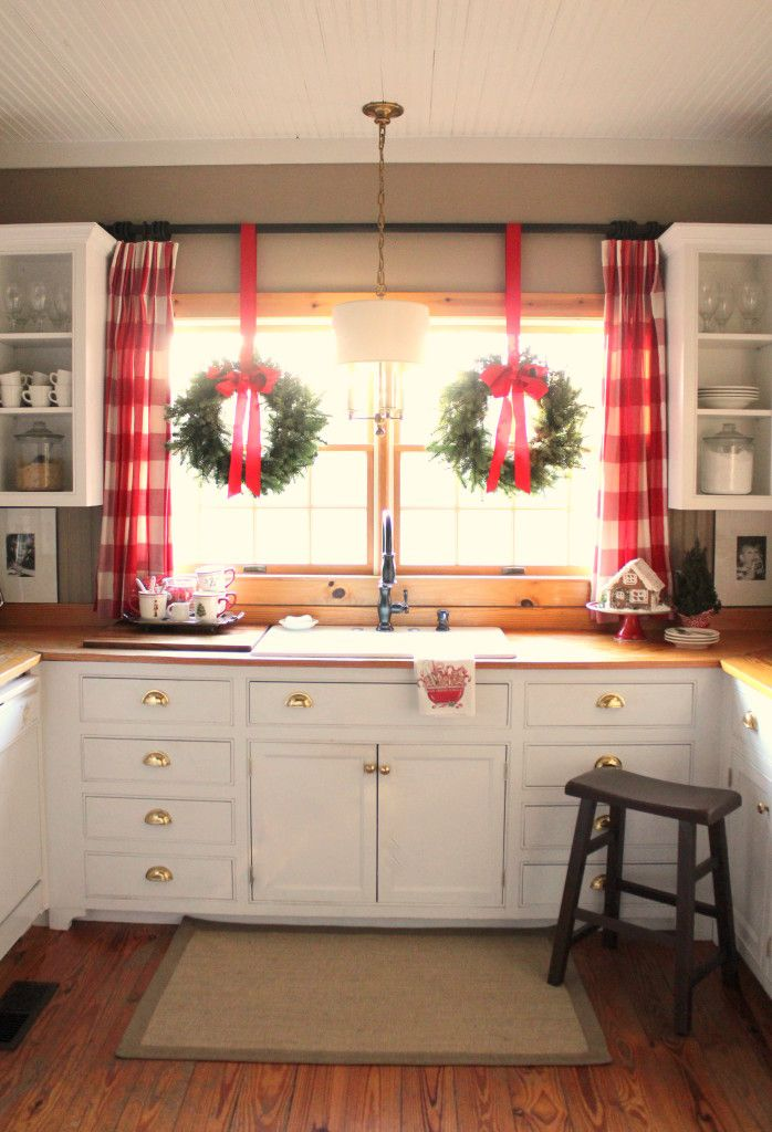 Buffalo check curtains add to the holiday charm and character of this  festive farmhouse kitchen! Diy Christmas Kitchen DecorChristmas ...