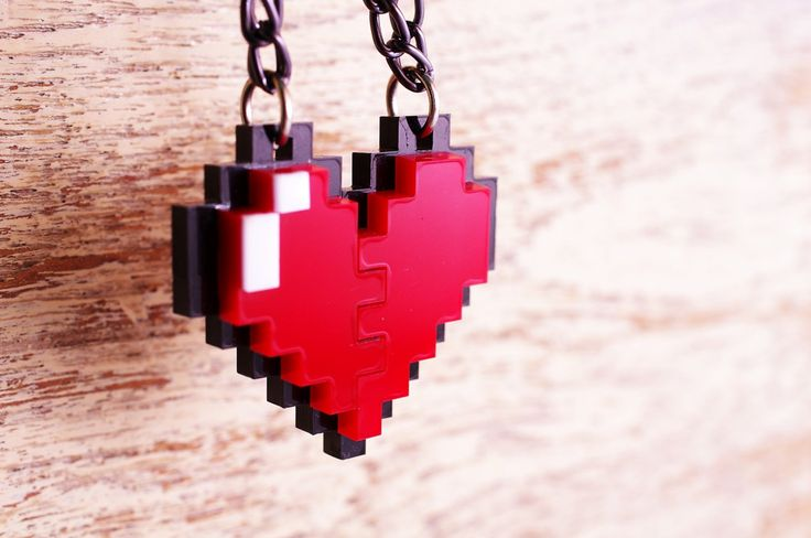 Pixel Heart Zelda Acrylic Plastic Pendent necklace for couple and gamer 8 bits design for couple and gamer. $11.00, via Etsy.