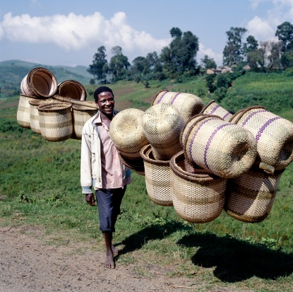 Southwest Uganda, Muko. Most women in Southwest Uganda carry their farm produce to the market in attractive split-bamboo baskets balanced on their heads. The baskets are made exclusively by men.