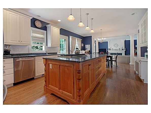 White cabinets with wood stained center island and navy for Kitchen center island cabinets