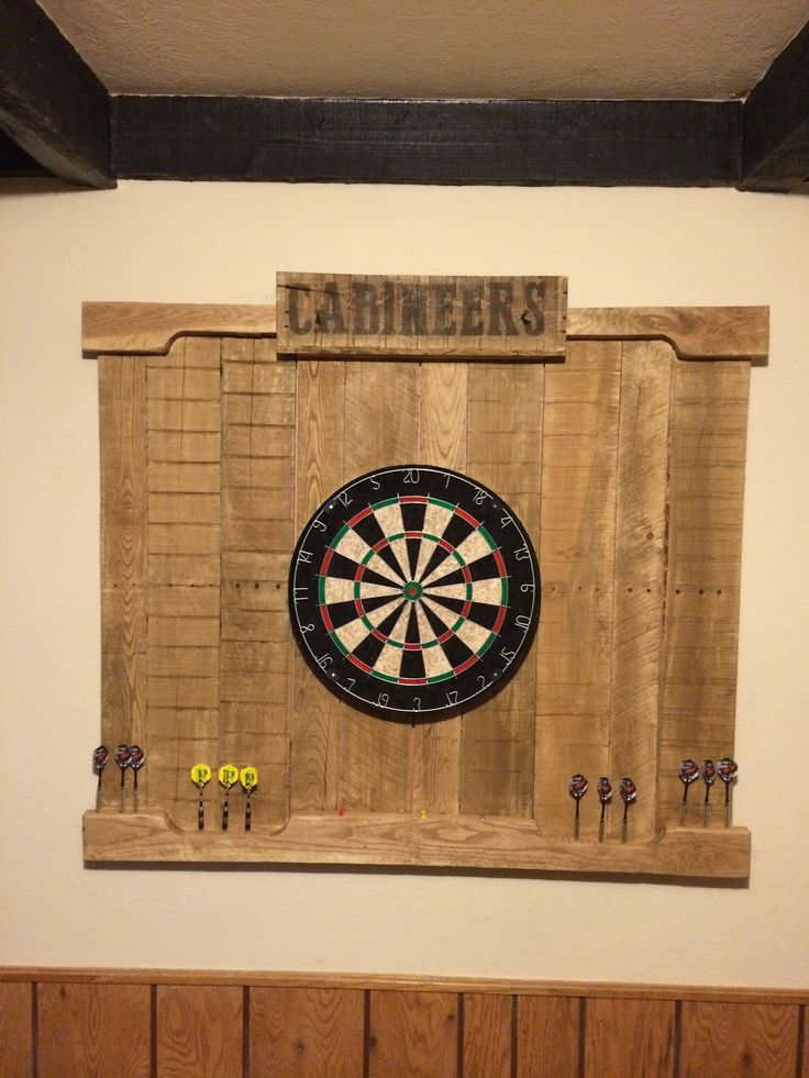 Here 39 s an easy diy wood project build your own dart board for Diy dartboard lighting