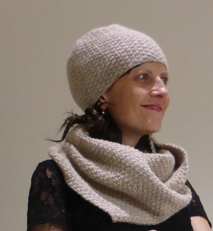 Knitting pattern for a scarf or cowl with matching beanie, in sizes 2 years to Man.
