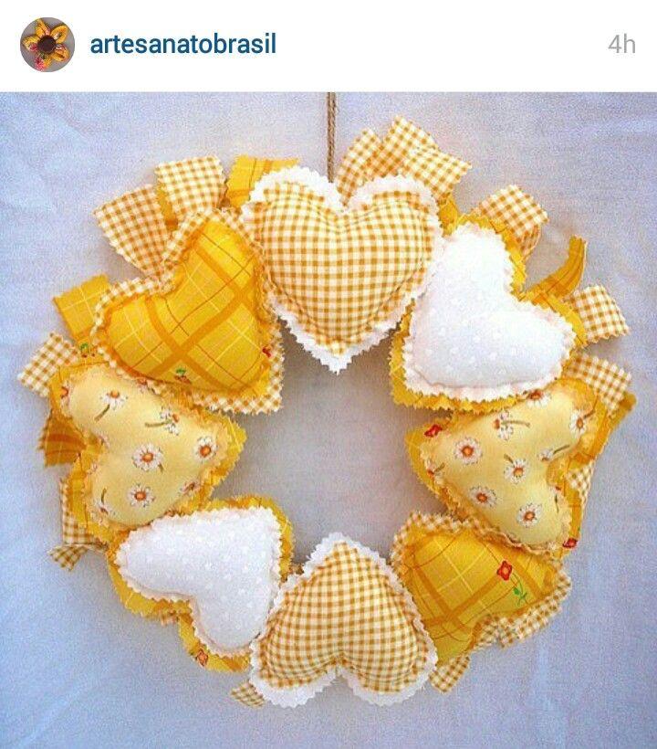 Instagram @artesanatobrasil - fabric wreath of stuffed heart shaped little pillows. Beautiful idea!