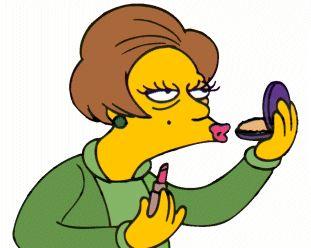 Edna Krabappel putting on makeup