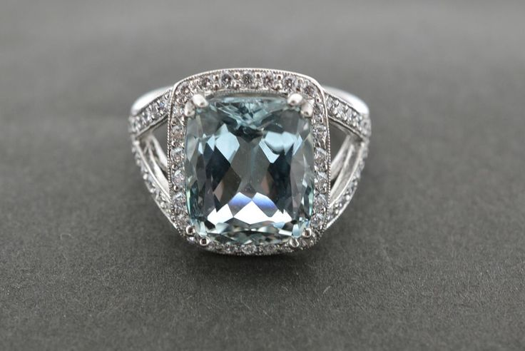 5.38ct aquamarine, set in a diamond and platinum halo with a split shank.