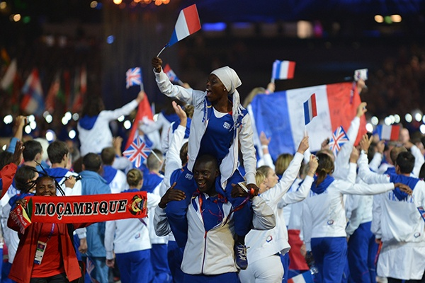 French athlete Ladji Doucoure, bottom, and Myriam Soumare react during the closing ceremony of the 2012 London Olympic Games. (Photo by Jewel Samad/AFP/Getty Images)