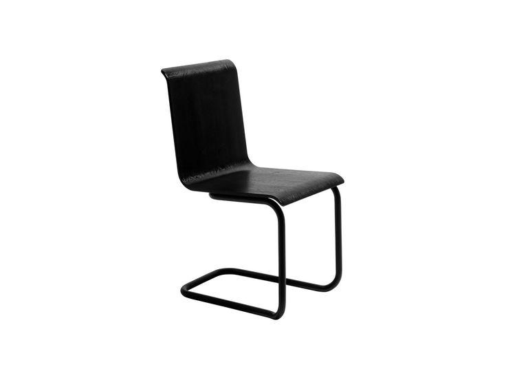 CHAIR 23. Designer: Alvar Aalto. Year: 1930. Frame painted black steel tube. Seat form pressed birch plywood.