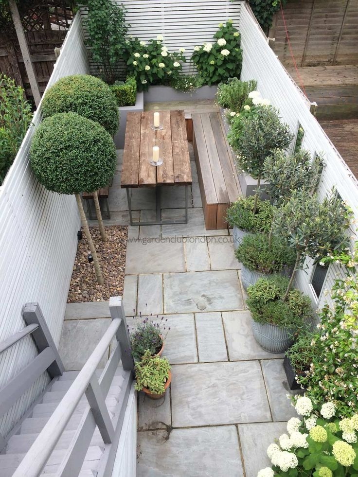 Slim rear contemporary garden design in London