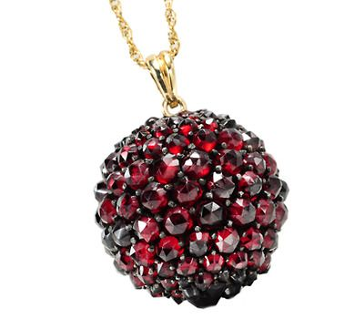 Bohemian Garnet Pendant: ca. 1890, 9k yellow gold, globe encrusted with pyrope garnets.