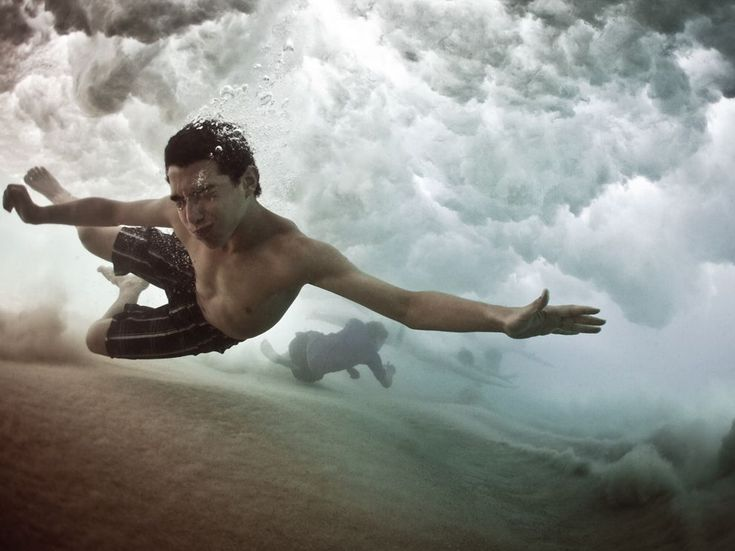 A swimmer stretches out to avoid the breaking wave at Coogee Beach, Sydney - National Geographic