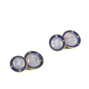 A pair of gold-mounted and enamelled jewelled cufflinks Fabergé, workmaster Henrik Wigström, St. Petersburg, 1908-1917 each pair comprising circular moonstone man-in-the-moon face set within guilloché deep blue surround encrusted with diamond stars connected by S-link to smaller version of the same, 56 standard.