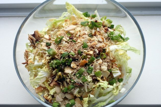 Ingredients:  1 medium head of cabbage, shredded 2 cups sliced fresh white mushrooms 1/2 cup sliced almonds, toasted 1/4 cup sunflower seeds 2 tbsp sesame seeds 2 green onions chopped 1 package instant noodles  Dressing: 1 seasoning packet from instant noodles 1/2 cup cooking (or olive) oil 3 tbsp white vinegar 1 tbsp soy sauce 1 tbsp sugar 1 tsp salt 1/2 tsp pepper