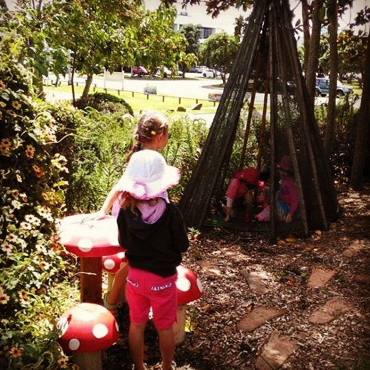 Lunching in the fairy garden at the Lake House Arta Centre, Auckland, NZ during our school holiday program.