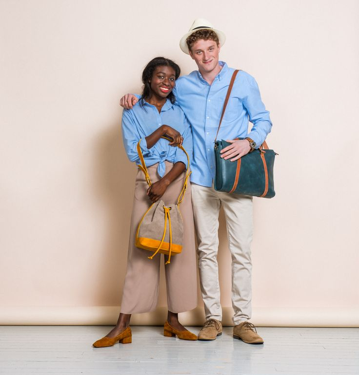 Ama carrying MARILIN bucket bag and Elias Gould carrying HARRI bag by MOIMOI Accessories. Photo by Veikko Kähkönen.