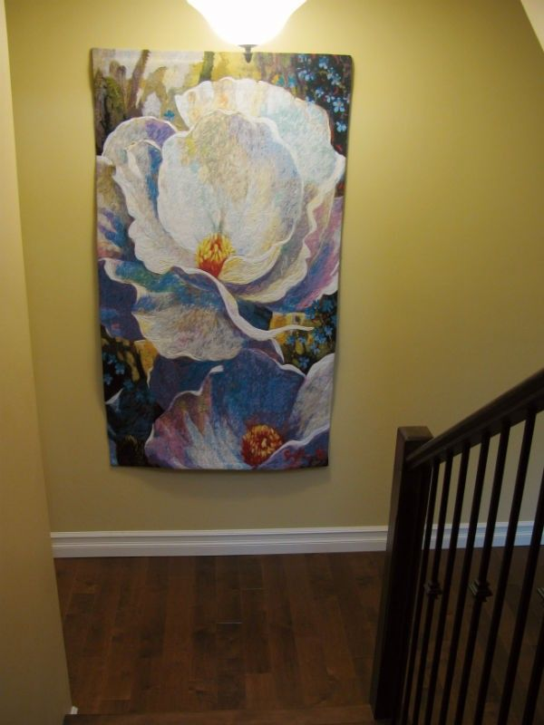 Morning Song tapestry at the foot of stairs in a Canadian home. It's from art by Simon Bull woven in Belgium.