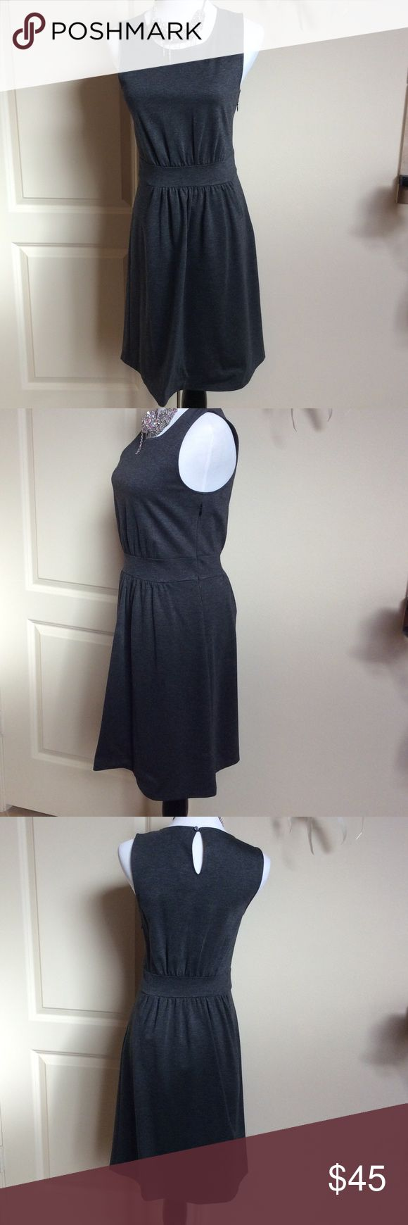 """Like new--Banana Republic gray cropped sleeve This cute dress is perfect for the office or a night out. Throw a colorful sweater on and go.  Tapered around the waist. Zippers under arm and button hole in back. Made of rayon, nylon and spandex. Dark gray color. Beautiful! Skirt is kind of gathered. Measures 12"""" shoulder to shoulder, dress length is 34.5, waist is 28"""", bust is 34"""". Wore once dry cleaned. Banana Republic Dresses Midi"""