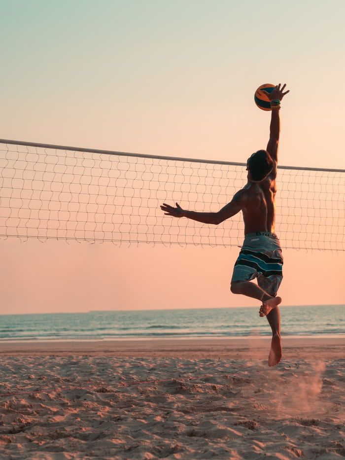 Man Playing Beach Volleyball During Daytime Sports Photography Sports Photos Volleyball Pictures