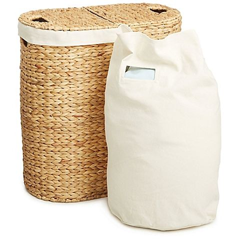 """Measures 24"""" H x 22-3/4"""" W x 13"""" D $64.99 Seville Classics Water Hyacinth Oval Double Hamper in Tan"""