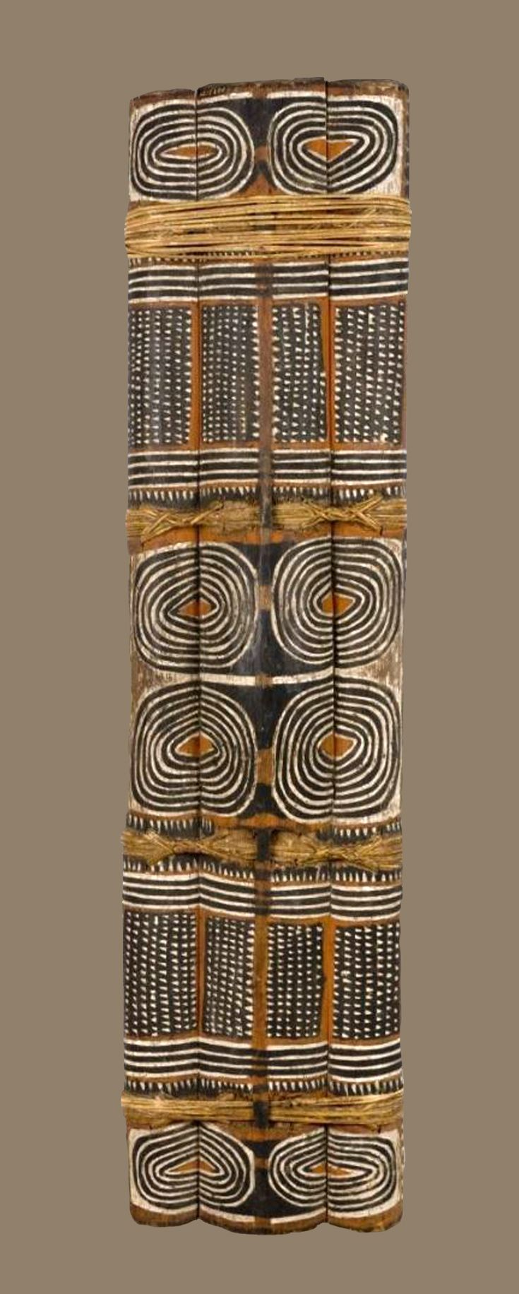 Shield from Arawe, New Britain, Papua New Guinea | Three decorated vertical slats bound together with strips of rattan. | ca. 1914