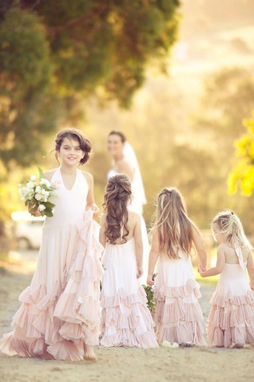 Light pink flower girl or junior bridesmaid.  Sweet, fun.