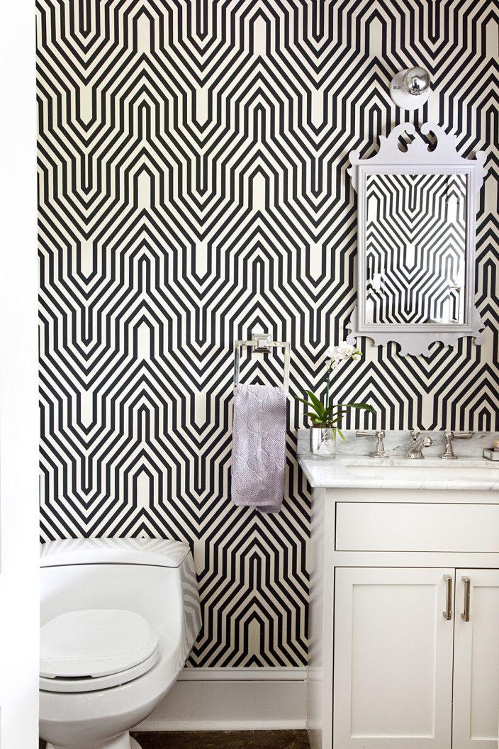 Striking bathroom design with black and white electric wallpaper design | Mona Ross Berman Interiors