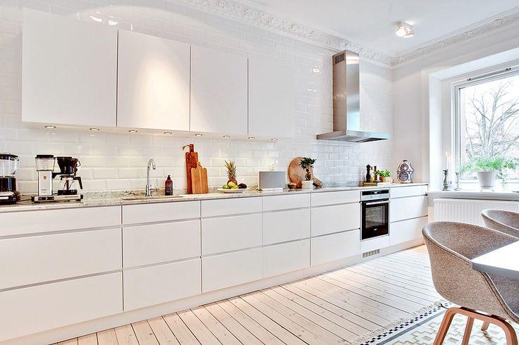 Kitchen. White. Galley. Open Space. Windows. Modern. Bright. Design. Decor. Interiors. Home.