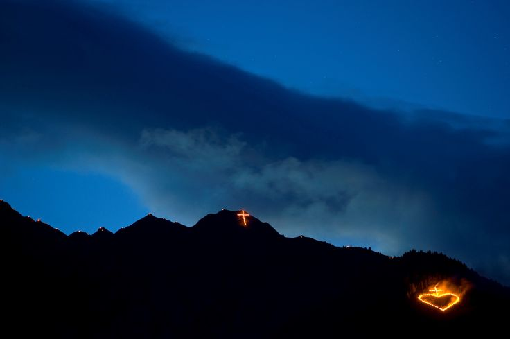 Every year in June the moutains of the Italian Alps in South Tyrol are burning due to an old tradtition: Sacred Heart Sunday! Roter Hahn - South Tyrol © Südtiroler Bauernjugend