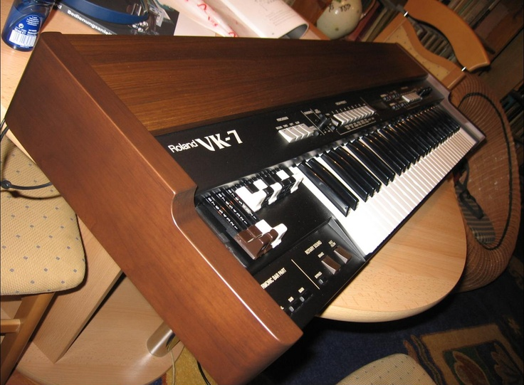 The Roland VK-7 uses modelling and samples of Hammond B3's  to recreate the Hammond sound.   The Roland also includes some extra sound patches, horns, strings, etc.    Decent organ sounds, bu the extra sounds aren't  worth much.   Except for the drawbar capabilities,  I think Roland's samples in its synths (especially the Fantoms) are a better.