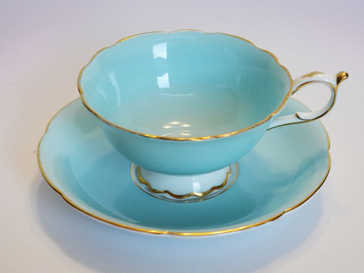 Paragon Turquoise Bone China Teacup and saucer - Footed with gold trim, Double Warrant by Trashtiques on Etsy https://www.etsy.com/ca/listing/547930494/paragon-turquoise-bone-china-teacup-and
