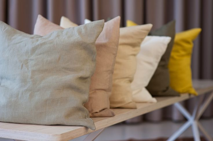 Pillows in Alba on bench from No Early Birds in our showroom in Stockholm.