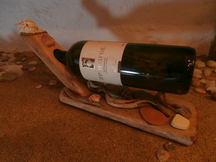 Olive wood wine bottle holder.