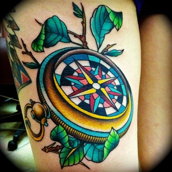 See more 3D colorful compass tattoo on leg