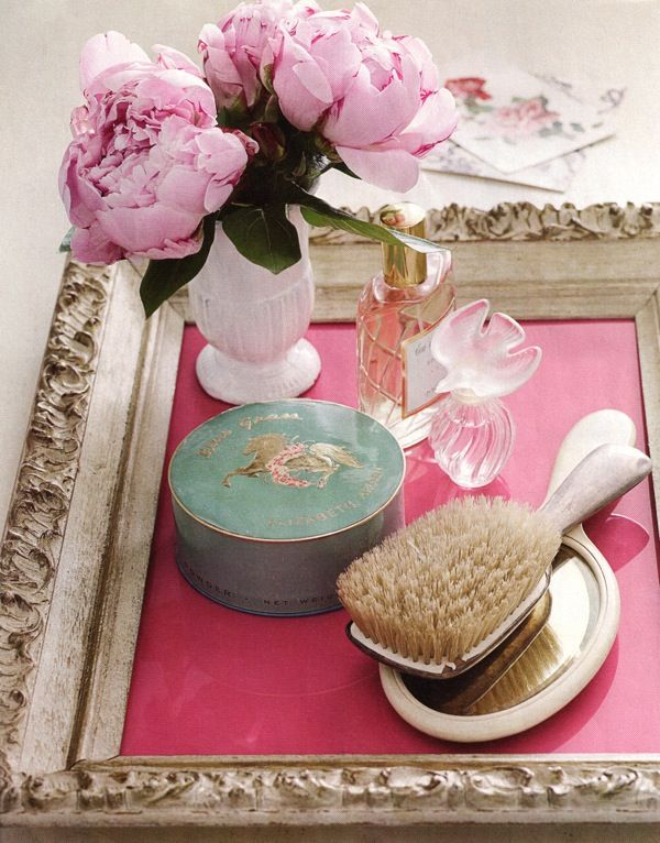 Take a vintage frame, throw a brightly colored piece of paper beneath the glass, place it on your vanity. And you have a cute new beauty station!