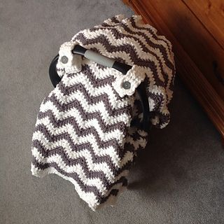 This is a PDF crochet pattern for a wonderfully soft car seat canopy cover blanket that works up surprisingly fast! It just takes 2 skeins (one of each color) of Bernat Blanket yarn. Would make a fantastic baby shower gift!