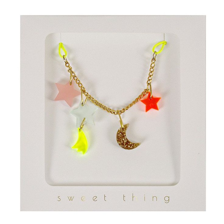 "A charming necklace with moon and star pendants suspended from a gold tone chain and neon yellow cord. 28"" cord/chain"
