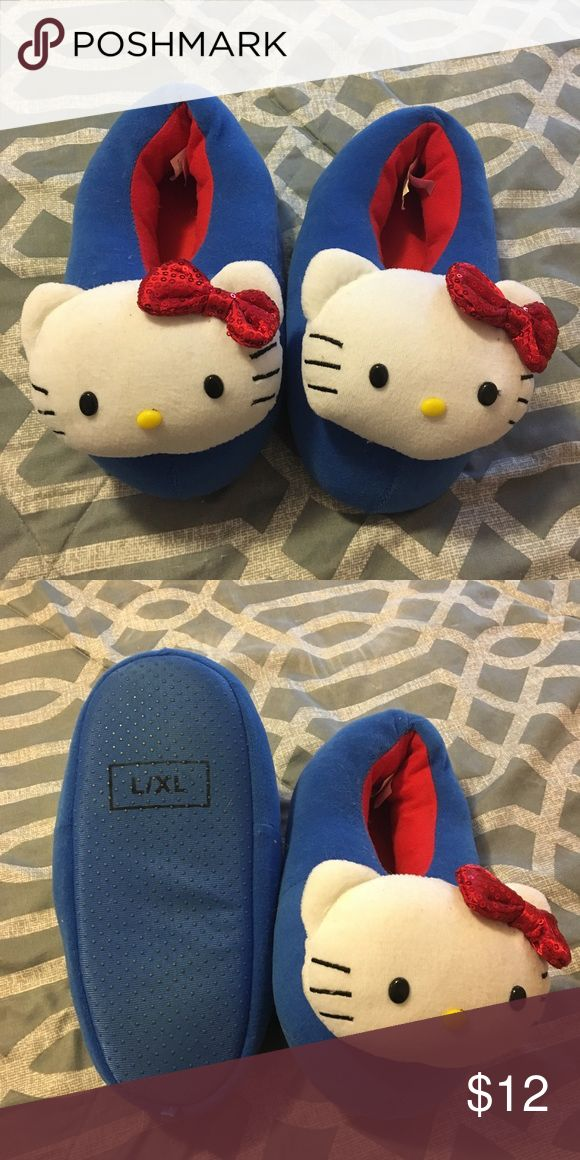 Target Hello Kitty slippers Super cute slippers from Target. Barely worn, no noticeable wear on the bottoms. Size L/XL Kid's shoes so would probably fit up to a size 7.5 in Women. I'm a size 8 and they're a bit snug on me Sanrio Shoes Slippers
