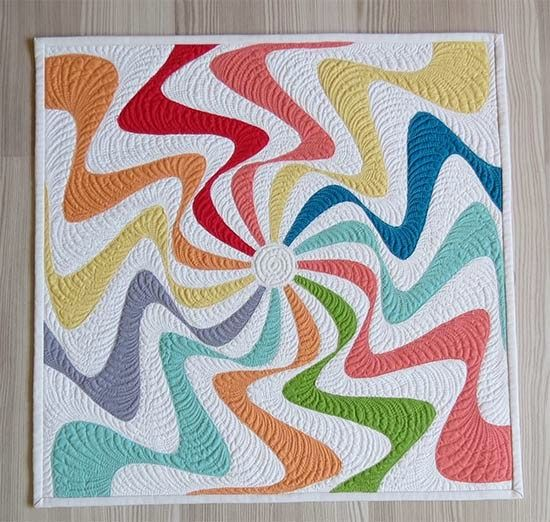 Fantastic swirl of color in this raw edged applique mini quilt designed by Geta Grama from Geta's Quilting Studio. This pattern is offered as a free tutorial