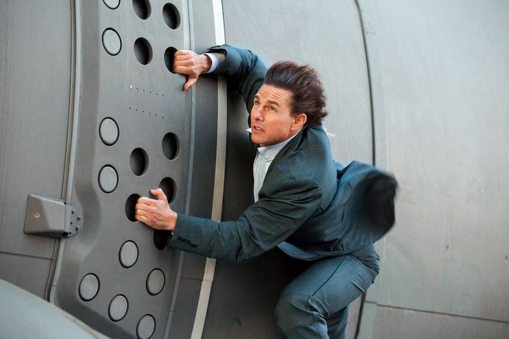 As agent Ethan Hunt, Tom Cruise has leaped from the world's tallest building, jumped off Shanghai's soaring skyscrapers, and scaled mountains bare-handed. But those stunts take a backseat to Mission: Impossible - Rogue Nation's standout opener, in which Cruise, 53, dangles precariously from a mammoth four-engine turboprop plane that pushes triple-digit speeds during a steep vertical takeoff.